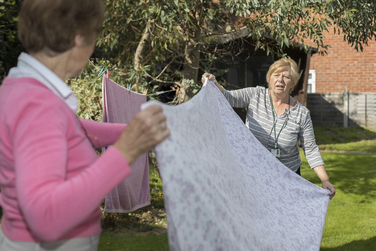Good Oaks Carer Helps Client Hang Washing