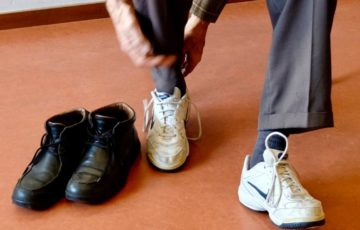 Person lacing shoes